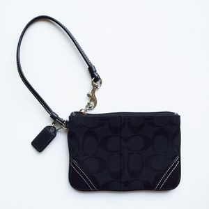 Coach black signature C wristlet.